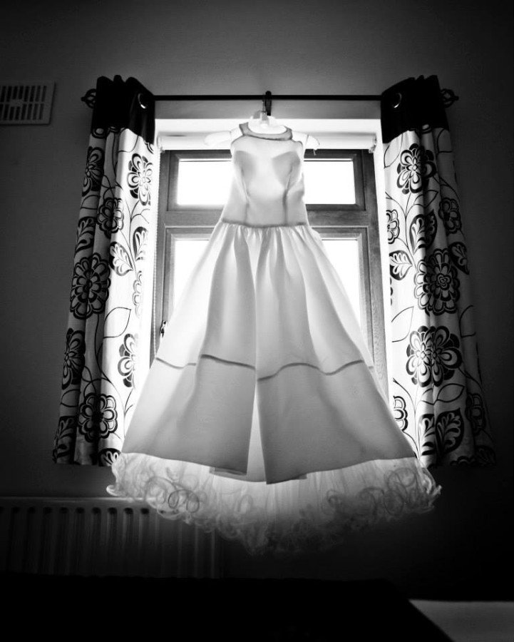 dress hanging in window