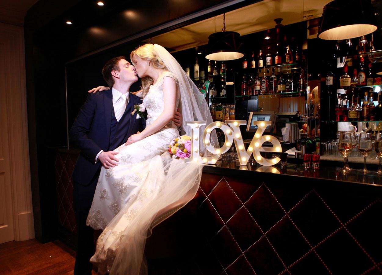 bride sitting on bar