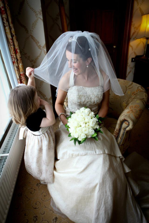 little girl playing with bride