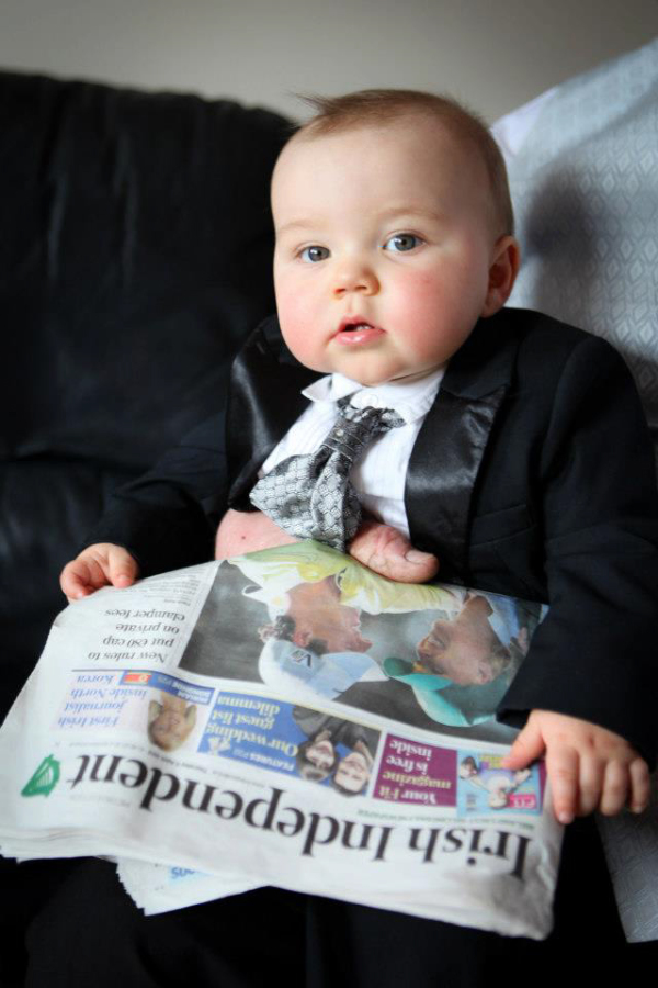 baby reading paper