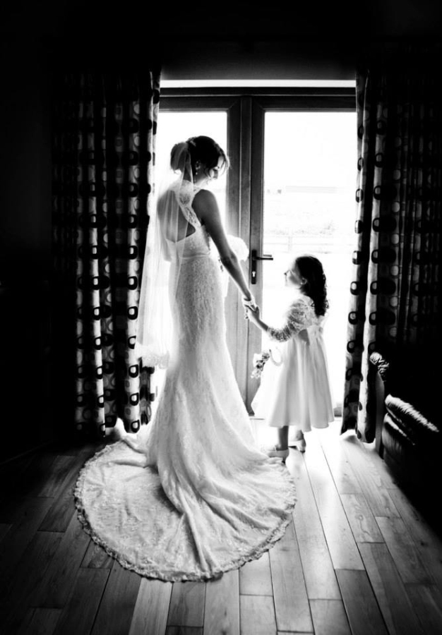 bride with girl in window