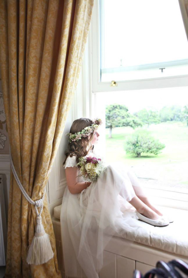 flower girl in window